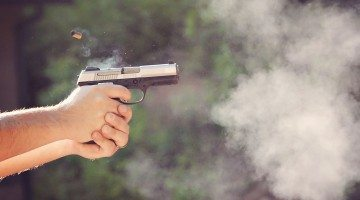 Gun ejecting bullet casing shots fired shooting