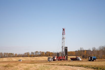 Oil Rig working in harmony within close proximity to farmland. Working on just harvestd fall field.