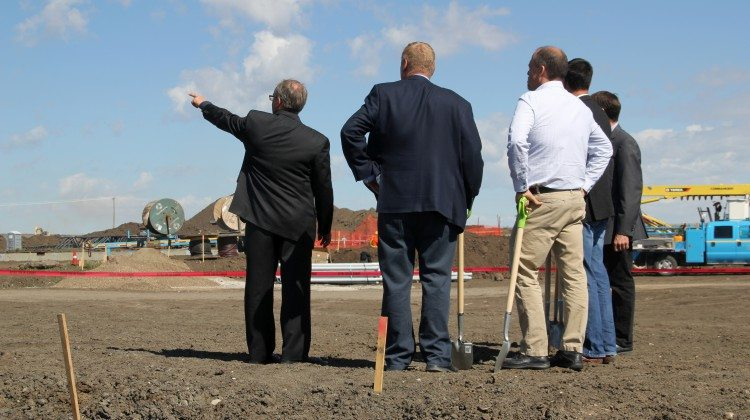 Grande Prairie Catholic Superintendent Karl Germann shows the new K-9 school site to MLA Wayne Drysdale, Board Chair Eldon Wyant, Mayor Bill Given, and MLA Todd Loewen.