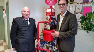Mayor Bill given makes the first red kettle donation with Salvation Army Major Brian Beveridge.