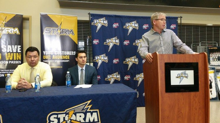 Grande Prairie Storm Coach Kevin Higo, Assistant Coach and Business Manager Dennis Rix and incoming Swan City Hockey Club President Murray Toews
